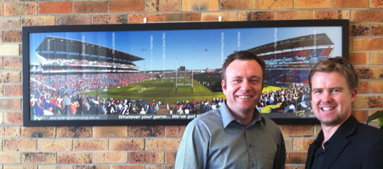 Josh Vincent presenting Board Room Image to Craig McGregor